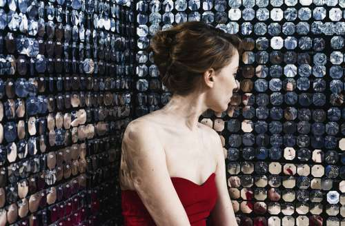 Woman Catches Her Reflection In A Wall Of Mirrors Photo
