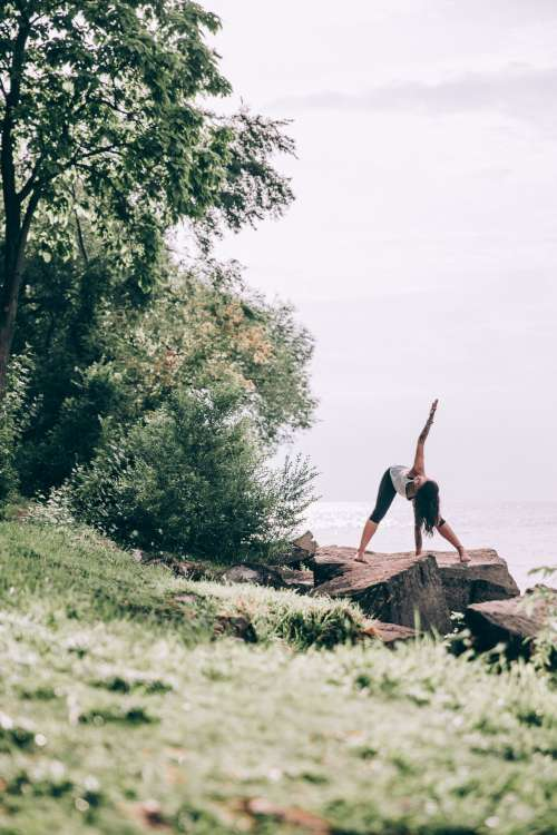Woman Does Yoga Outdoors Photo
