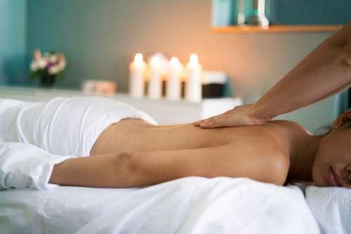 Woman Getting Back Massage Photo