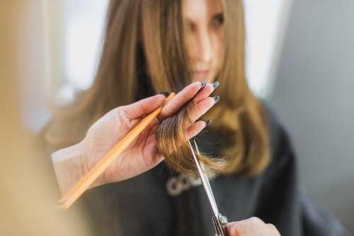 Woman Getting Hair Cut At Salon Photo