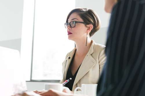 Woman In Glasses At Meeting Photo