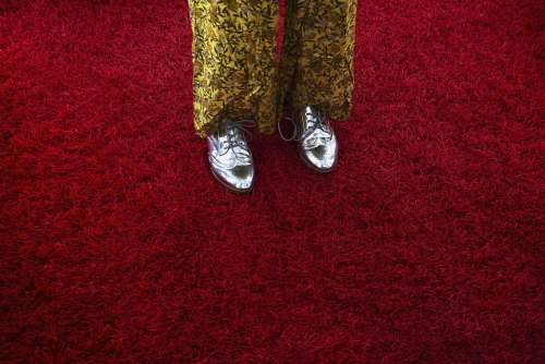 Woman In Silver Oxfords Crossing Red Shag Carpet Photo