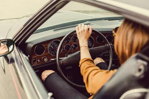 Woman In Vintage Car Photo