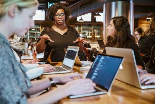 Woman Instructing On Laptop Photo