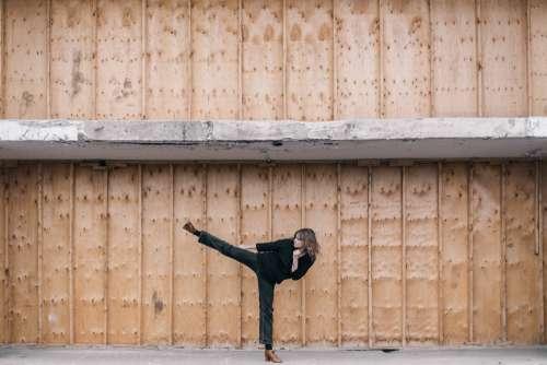 Woman Kicking Photo