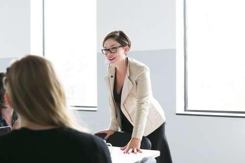 Woman Leads Team Meeting Photo