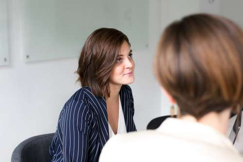 Woman Listening At Team Meeting Photo