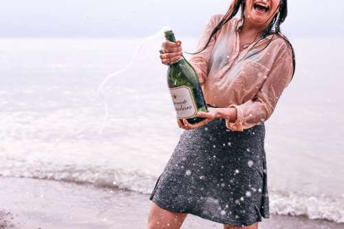 Woman Popping Champagne Photo