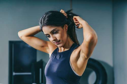 Woman Prepares For Workout Photo