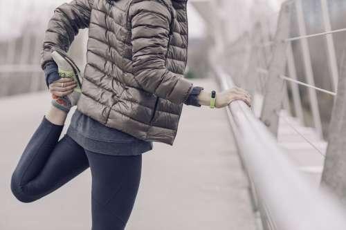 Woman Stretching Before Run Photo