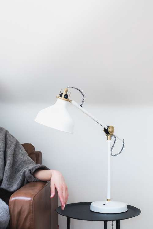 Woman's Hand On An Armrest Under A Lamp Photo