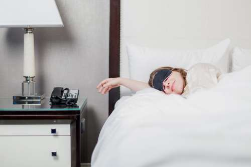 Woman Sleeping In Hotel Room Photo