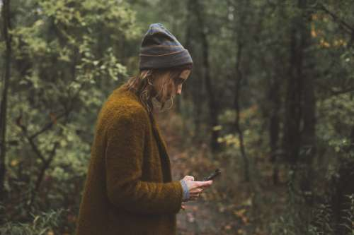 Woman Texts During Autumn Hike Photo
