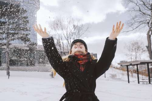 Woman Throwing Snow In Park Photo