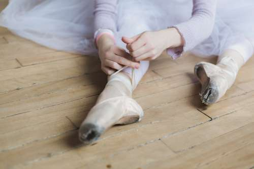Woman Ties Dance Shoes Photo