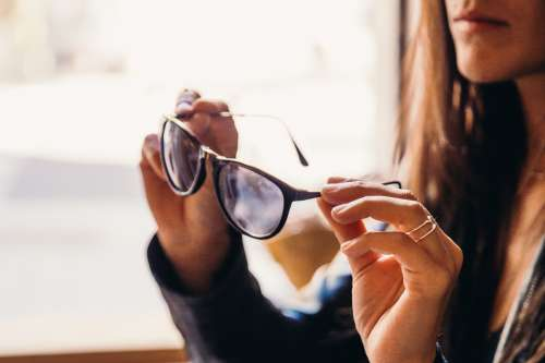 Woman Trying On Sunglasses Photo