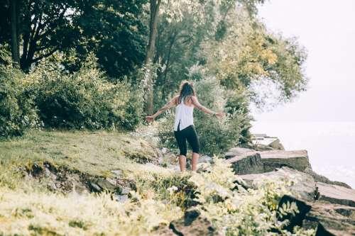 Woman Walks Down To Waters Edge Photo