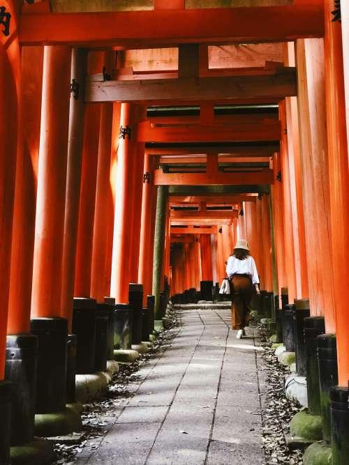 Woman Walks Up A Historical Japanese Path Photo