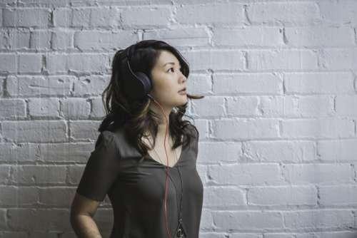 Woman Wearing Headphones Photo