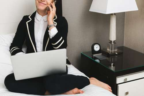 Woman With Laptop In Hotel Photo