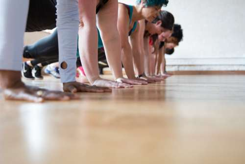 Women In A Row Plank Pose Photo