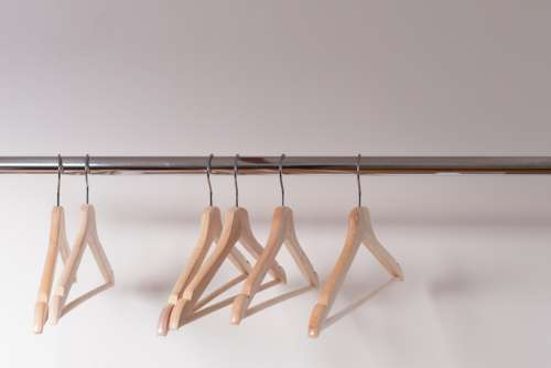 Wooden Clothes Hangers Cling Emptily To The Shiny Shop Rack Photo