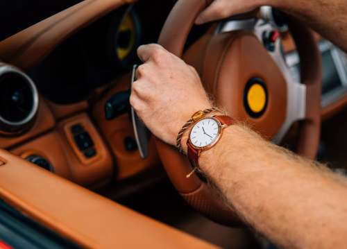 Wrist Watch On Driving Arm Photo