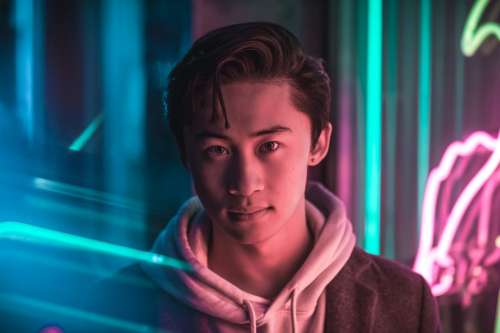 Young Adult With Bright Neon Lights Photo