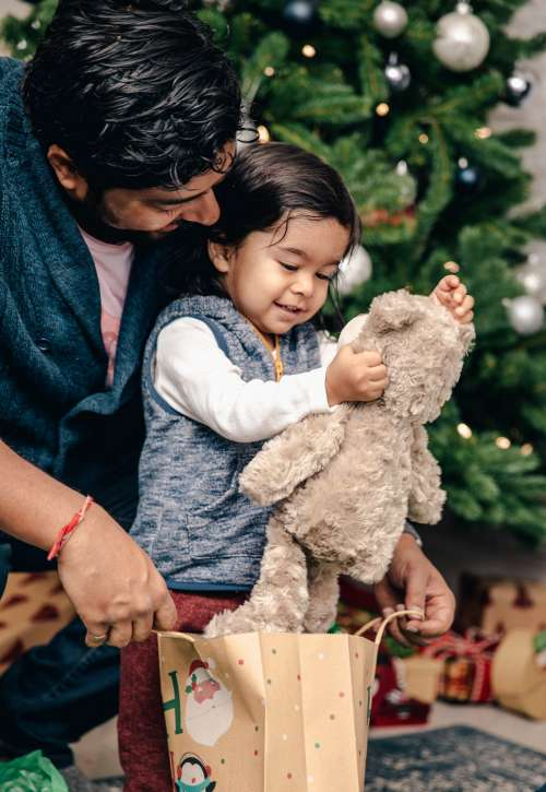Young Boy Receives Teddy Bear For Christmas Photo