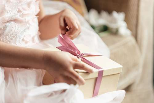 Young Girl Opening Gift Photo