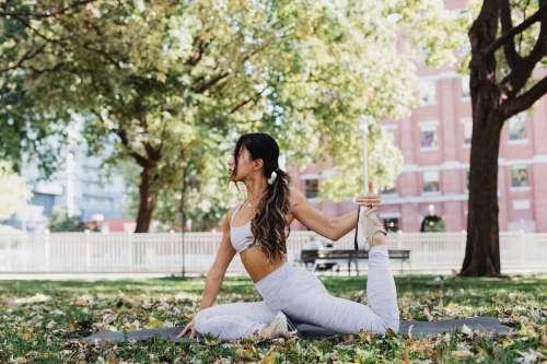 Young Woman Doing Yoga In Park Photo