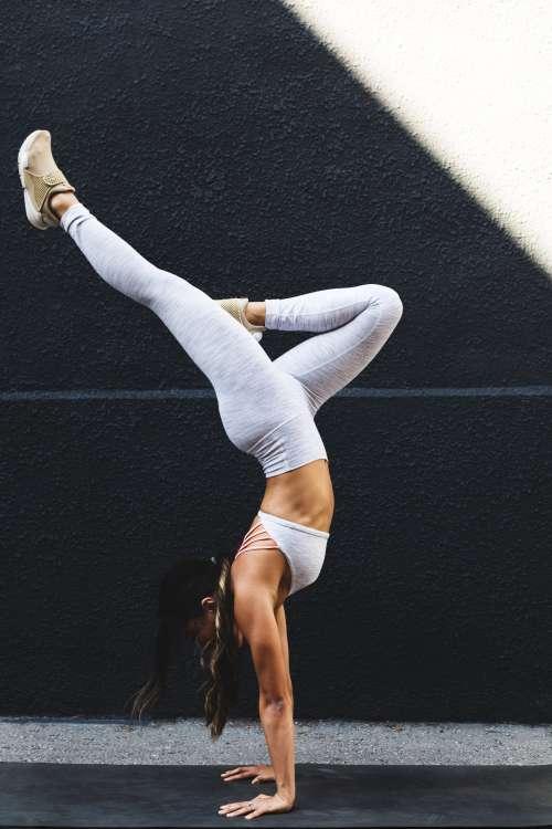 Young Woman Doing Yoga Outside Photo
