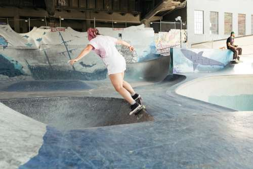 Young Woman In Pink Skating A Bowl Photo