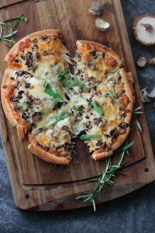 Pizza with cheese and mushrooms