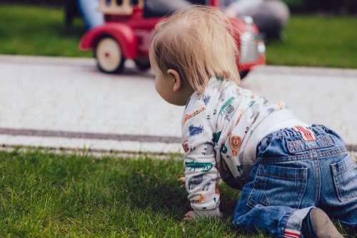 Baby boy crawling outdoors