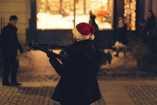 Christmas street guitar player