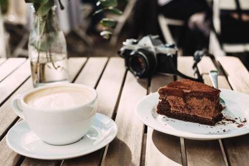 Coffee, chocolate cake and an analog camera