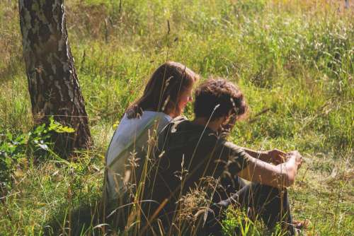 Couple sitting in the meadow