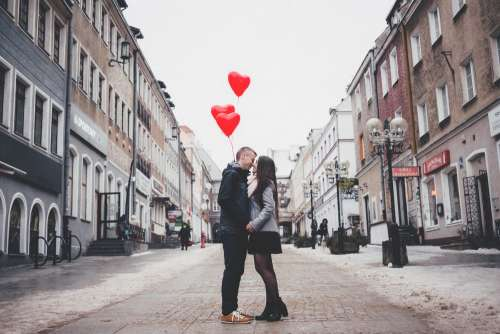 A couple with heart shape baloons 2