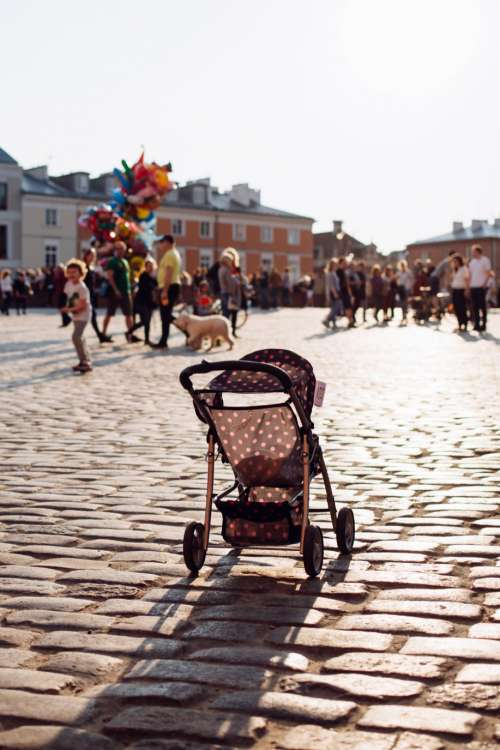 Empty stroller in a crowded Old Town square 2