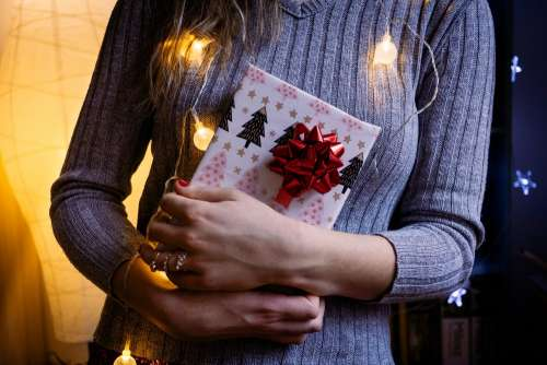 A female holding a christmas gift 4