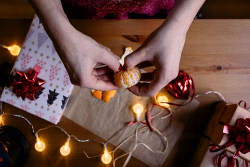 A female peeling a mandarin in a festive setting 2
