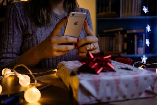 A female taking picture of a christmas gift 4
