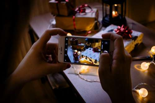 A female taking picture of a christmas gift 5