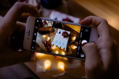 A female taking picture of a christmas gift 6