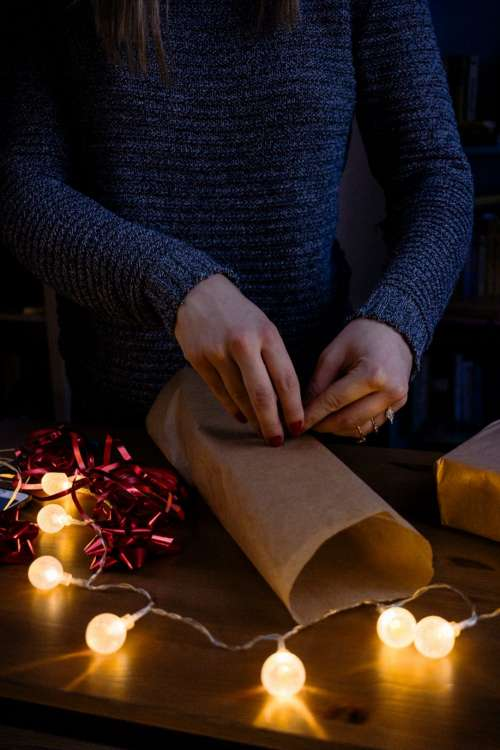 A female wrapping a gift