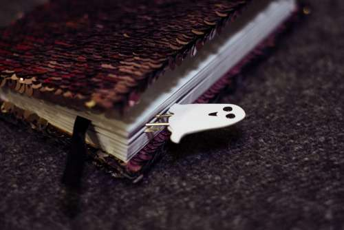 A ghost paperclip in a notebook