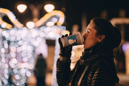 Girl drinking coffee in winter
