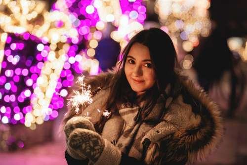 Girl holding a sparkler 2