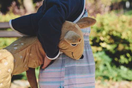 A girl holding plush Bambi